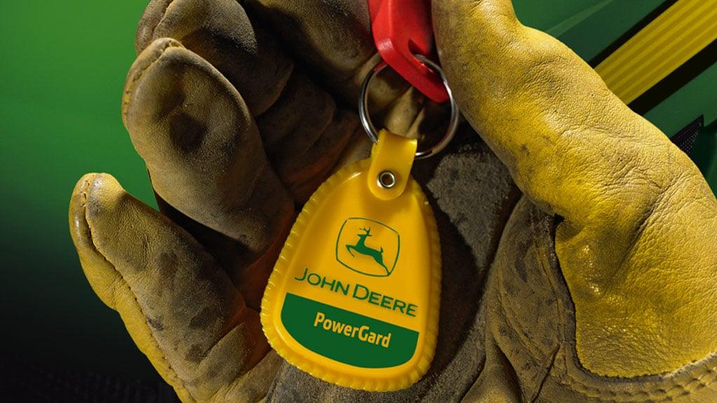 close up image of gloved hand holding keys